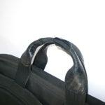 持ち手の革が破れたTUMIの鞄