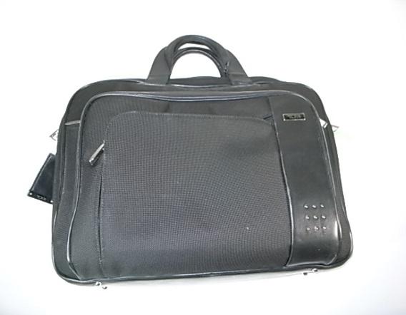 修理前のTUMIの鞄